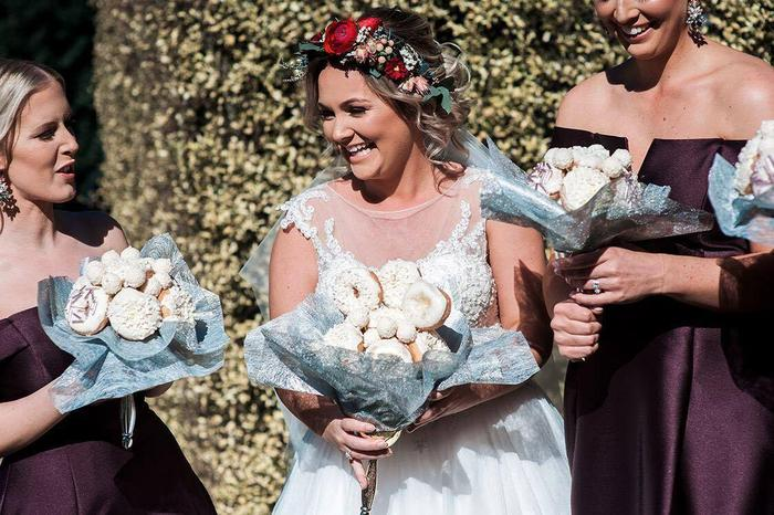 Paige and her bridesmaids, with the bouquets.