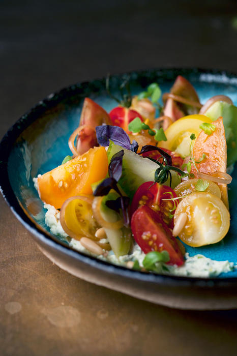 Tomatoes with wasabi mascarpone and pine nuts