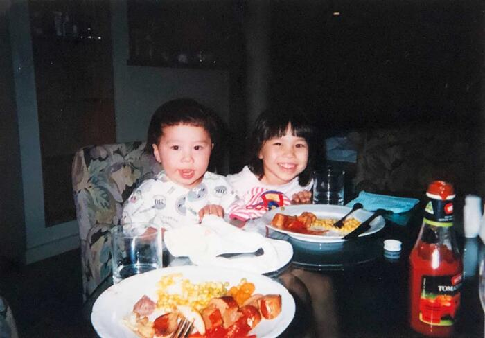 Anne Masayo Hasegawa and her brother enjoying a holiday breakfast.