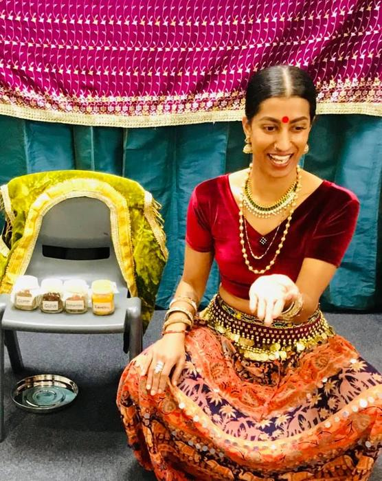 Shyamla Eswaran with her spice tin, as she teaches children about cultural acceptance with food.