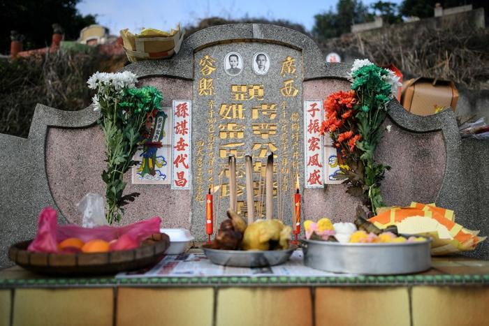 During the Qingming festival, also known as Tomb Sweeping Day, people tend the graves of their departed loved ones, burn goods and offer foods.