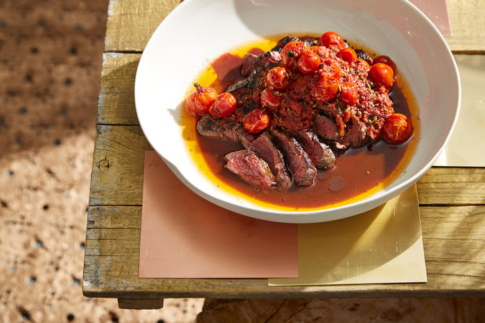 Chargrilled hanger steak with fennel and chilli oil roasted cherry tomatoes