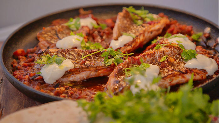 Harissa bream with flat bread and homemade labneh