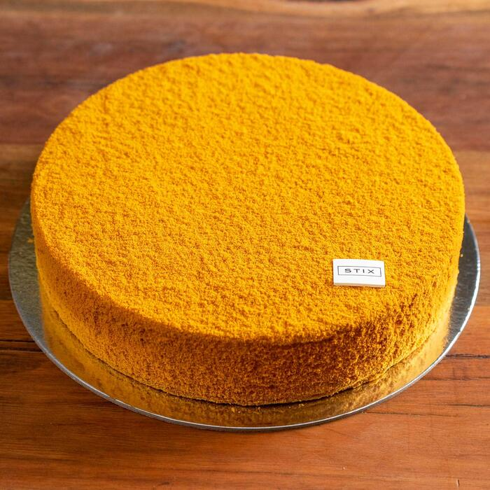"""You'll find """"whisper-thin honey biscuits and a dulce de leche and sour cream filling"""" inside the cake."""