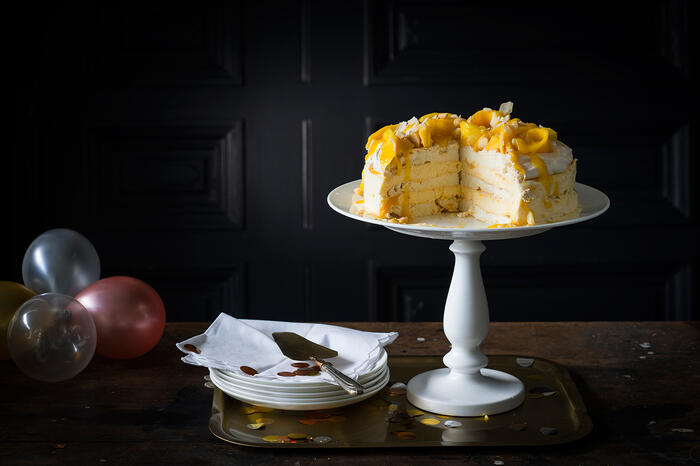 Mango, coconut and lime iced cake