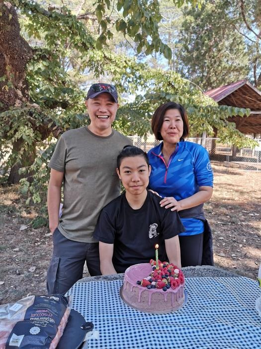 Ivan and wife Liwe with Marcus celebrating his birthday with a gluten-free cake.