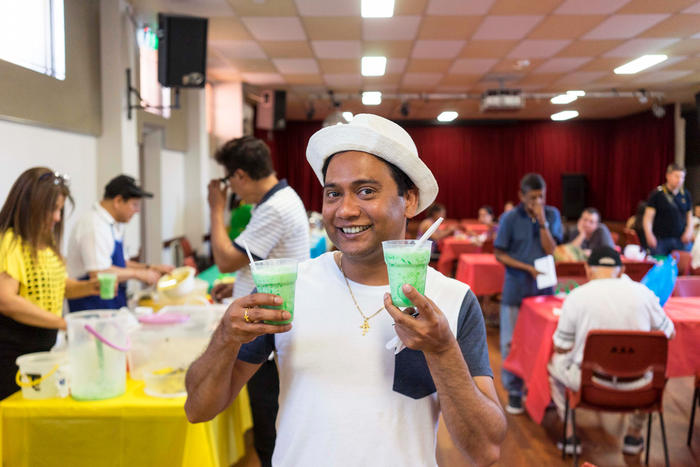 BAWA president Michael D'Souza with falooda at the fete.