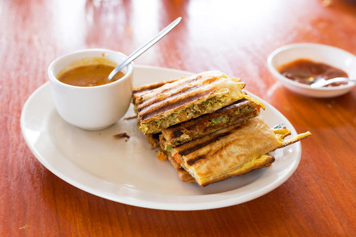 The roti murtabak comes with a curry dipping sauce.