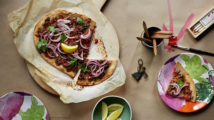 Spicy lamb pizza with pickled red onions