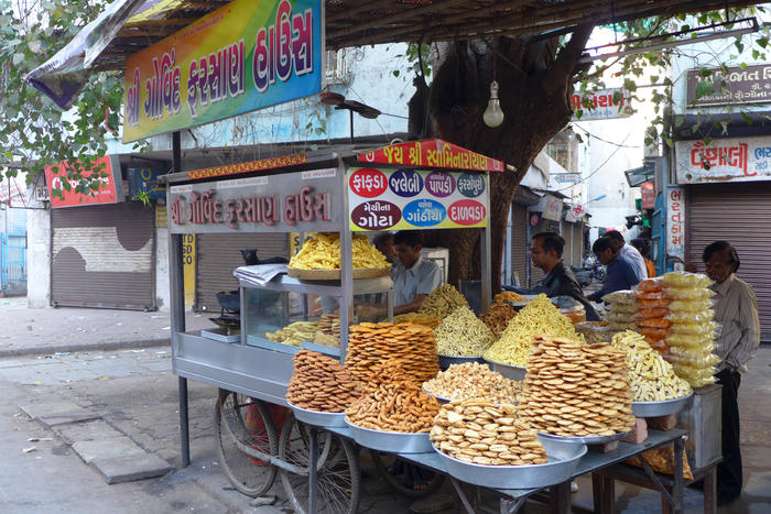 One of the many colourful snack vendors that line the streets of India.