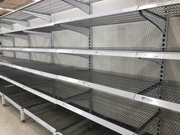 Panic-buying and product shortages has led to empty shelves at supermarkets.