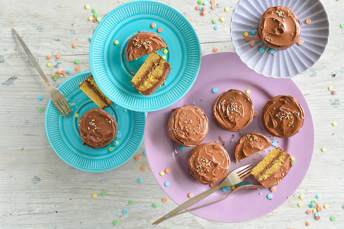 Yellow cakes with chocolate fudge frosting