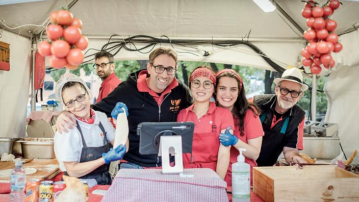 Ettore Donnaloia and his staff serving his bolognese panzerotto at his travelling market stall in Melbourne.