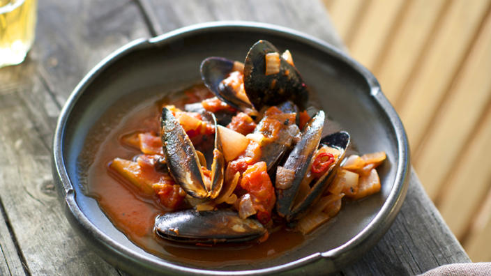 Baked mussels in a charred onion and saffron broth
