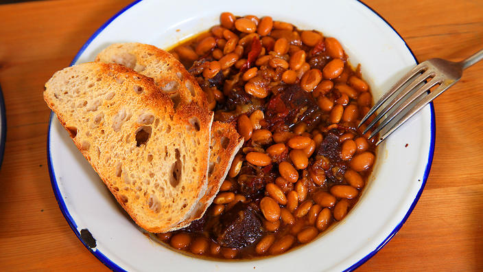 Baked beans with black pudding.