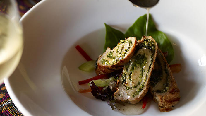 Rolled veal with Warrigal greens pesto