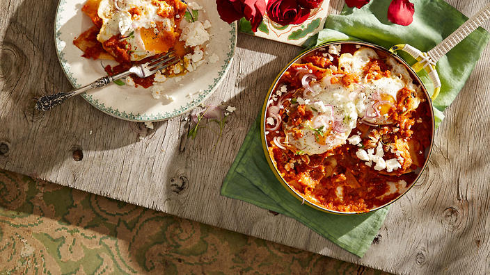 Tomato and chipotle bathed corn chips with fried eggs (chilaquiles rojos)