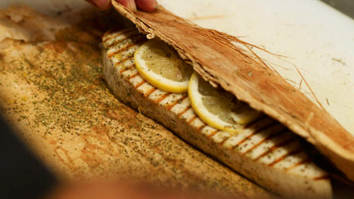 Lemon-infused fish cooked in paperbark with herb butter