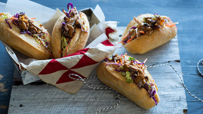 Spicy pulled pork rolls with coleslaw and barbecue sauce