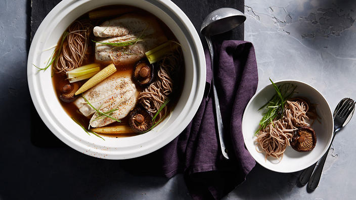 Japanese-style mushroom and leek broth with poached fish