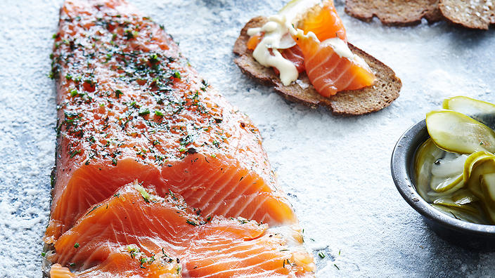 Salmon gravlax with Dijon crème fraîche dressing and pickled cucumbers