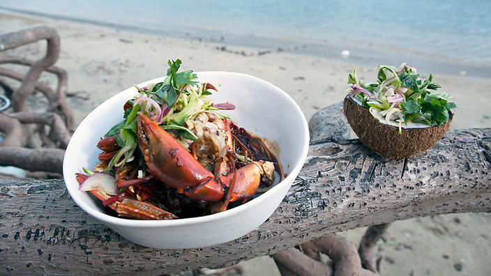 Chilli mud crab with green mango, coconut and herb salad