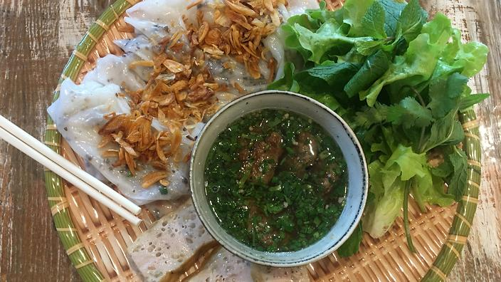 Banh Cuon Ba Oanh: The batter is thinly spread on the steamer to make the rice noodles.