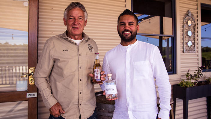 Phillip Ugle (right) proudly displays his The Forager 'Boodja' Gin with Karl Hillier of Harris River Estate.