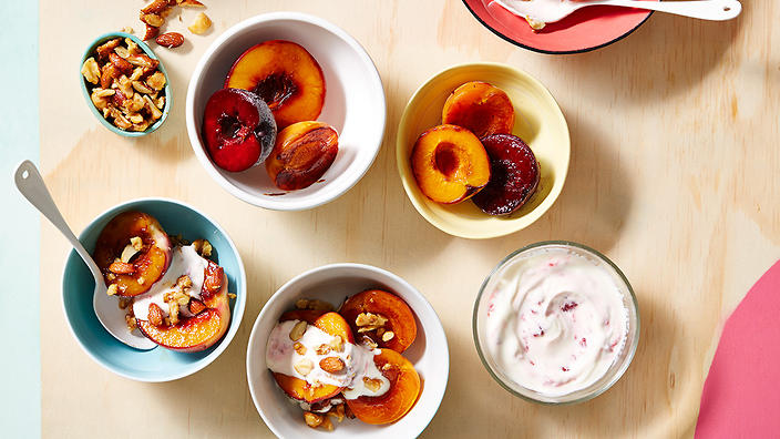 Caramelised stone fruit with crunchy nut crumble and raspberry yoghurt