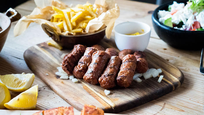 The grilled skinless sausage cevapi or ćevapčići comes in traditional or slider form.