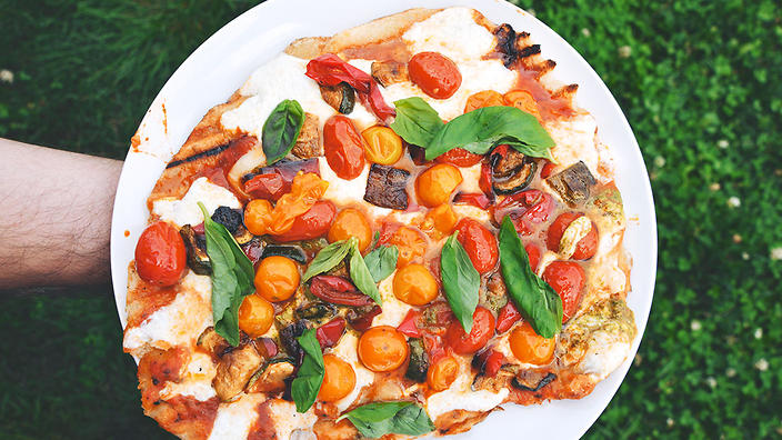 Barbecued pizza with roasted cherry tomato and garlic scape pesto