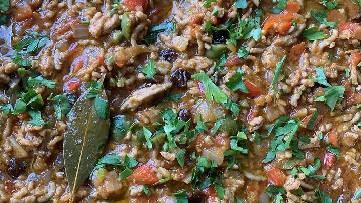 Picadillo is often served with tostones, savoury fried plantains, on the side.