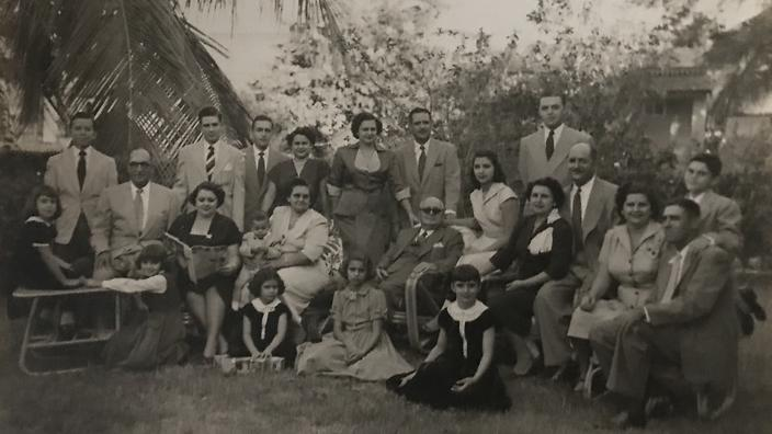 The Palomo family with Alvarez's grandmother Aida in the centre, holding her uncle as a baby.
