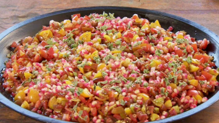 Tomato and pomegranate salad with garlic dressing recipe : SBS Food