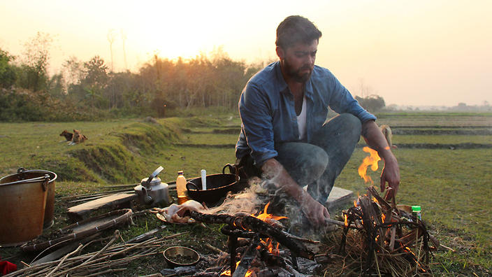 Pablo Naranjo Agular cooks during a visit to the Bodo tribe