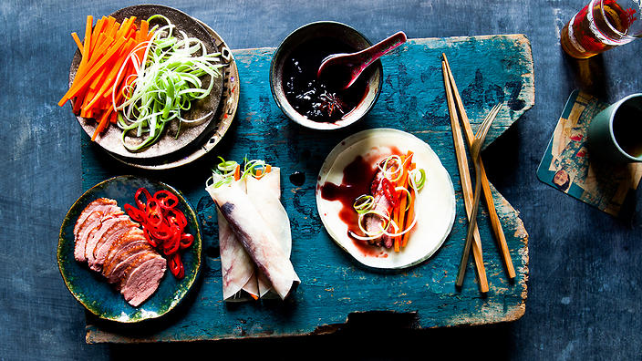 Tea-smoked duck with Chinese pancakes and cherry sauce