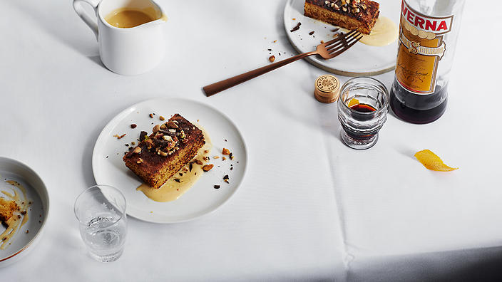 Olive oil cake with orange scented custard and nuts
