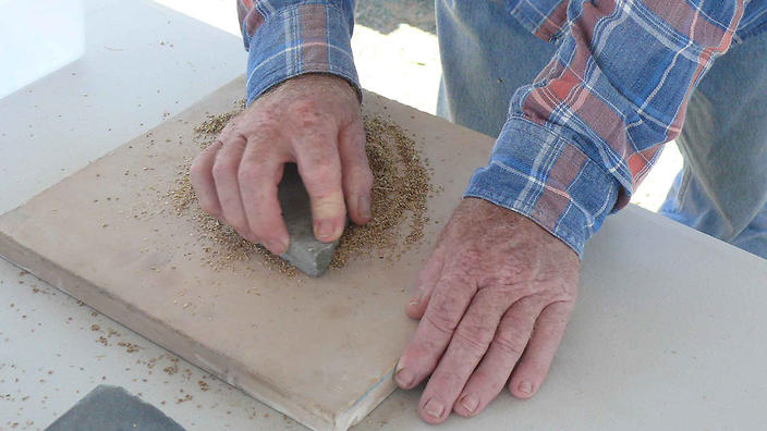 Bruce Pascoe grinding grains for Mungo bread.