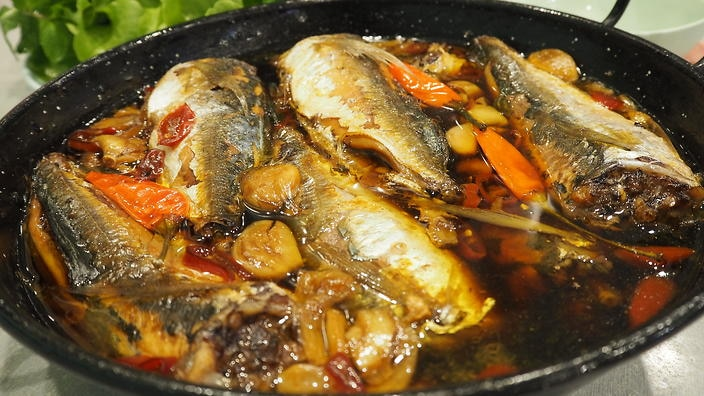 Vietnamese Bau Truong: Chili, garlic and mackerel slow-cooked until it's tender, rich and the bones are soft enough to melt in your mouth