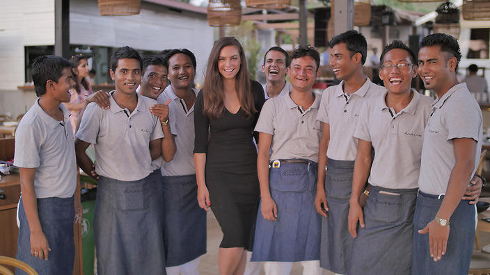 Sarah Todd with staff in My Restaurant in India