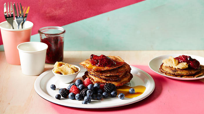 Paleo choc chip pancakes with nut butter and berry jam