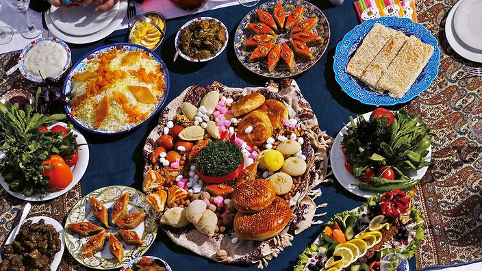 Attractive Iranian New Year. A Feast Table Set With A Variety Of Nowruz Sweets,  Including Guba Baklava And Sheki Halva. In The Middle Of The Sweets Is  Sprouted Wheat, ...