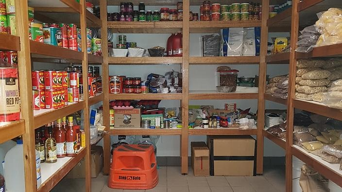 Antarctica: The non-perishables pantry: Donna and helpers replenish this weekly from stocks in the main Green Store