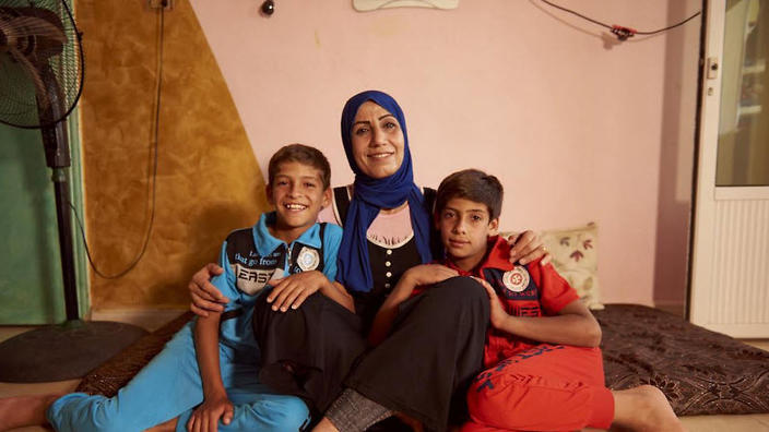 Fatima with her twin sons Majdi and Fathi (aged 11).