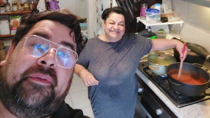 Eddy and Hennie Urias-Castro in the kitchen on Mothers Day 2021.