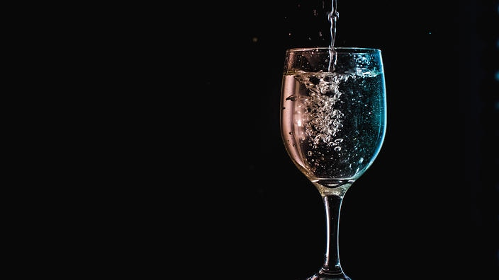 Drink water from a wine glass