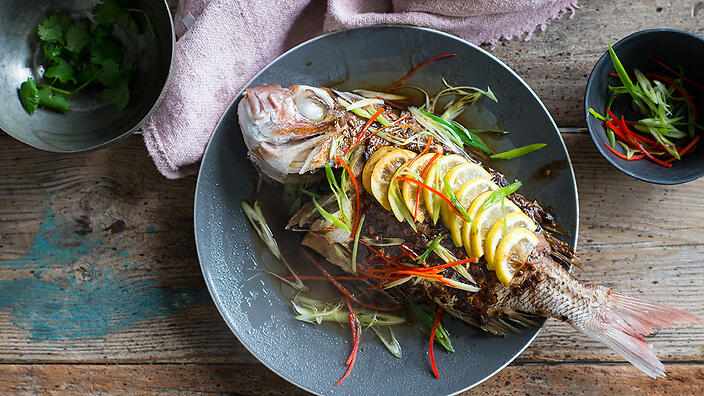 Whole snapper steamed with black beans, lemon and chilli