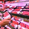 A shopper browses cuts of beef at a supermarket in Perth