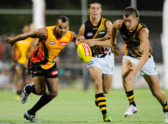 All Stars player Eddie Betts and Richmonds Dustin Martin compete for the ball during the AFL pre-season match between the Indigenous All Stars and Richmond in Alice Springs, Friday, Feb. 8, 2013. (AAP Image) NO ARCHIVING, EDITORIAL USE ONLY