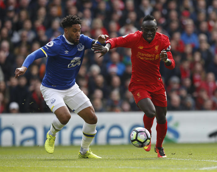 Ashley Williams of Everton in action with Sadio Mane of Liverpool during the English Premier League match at Anfield Stadium.